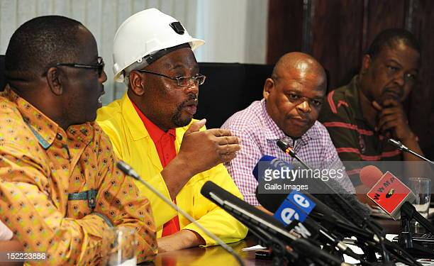 General Secretary Zwelinzima Vavi with the unions President Sdumo Dlamini and the General Secretary of the National Union of Mineworkers Frans Baleni...