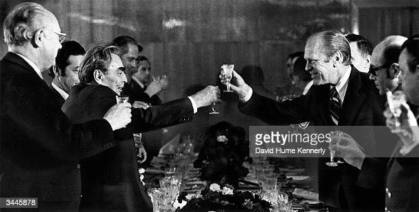 General Secretayr of the Soviet Union Leonid Brezhnev leads a toast with American President Gerald Ford over dinner as part of the second set of...
