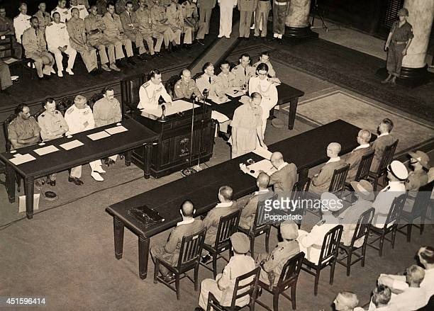 General Seishiro Itagaki of Japan signs the document of surrender in the presence of amongst others Lord Louis Mountbatten Supreme Allied Commander...