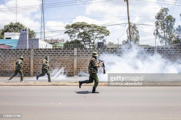 General Service Unit officers chase medical students during a protest outside the Kenyatta National Hospital called by Kenya Medical Practitioners,...