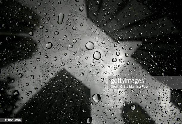 General shot of a cluster of buildings in Wan Chai in the rain when standby signal number one is hoisted as Tropical Storm Ketsana passes by the...