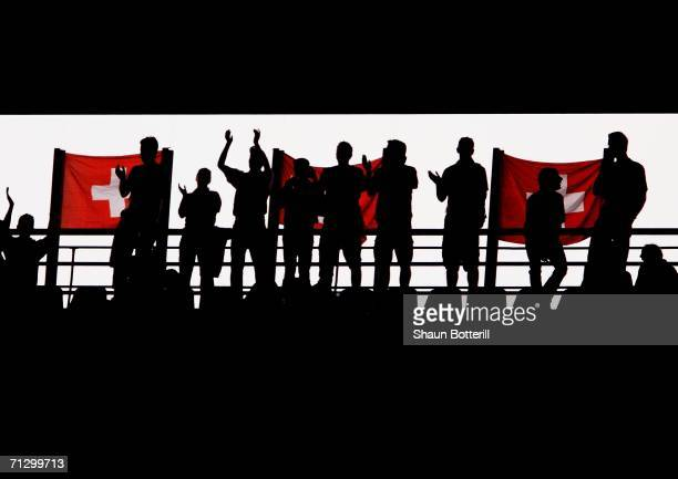 General silhouetted view of Swiss fans and flags prior to the FIFA World Cup Germany 2006 Round of 16 match between Switzerland and Ukraine played at...