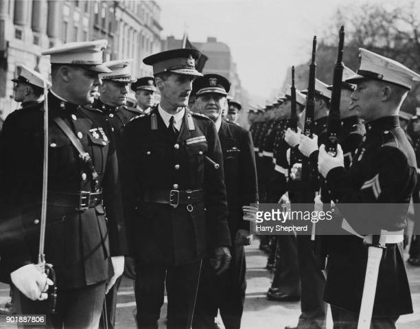General Sir Alan George Barwys Bourne AdjutantGeneral of the Royal Marines inspects a detachment of the United States Marine Corps in Grosvenor...