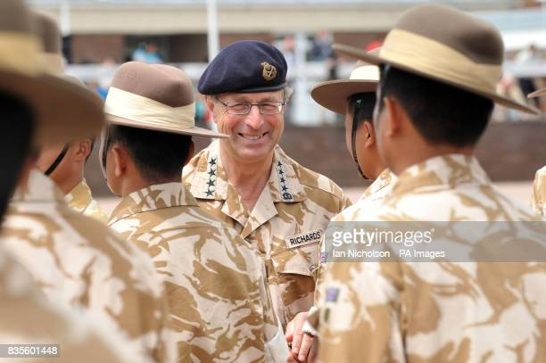 General Sir David Richards awards campaign medals at parade to honour members of the 2nd Battalion the Royal Gurkha Rifles following their return...