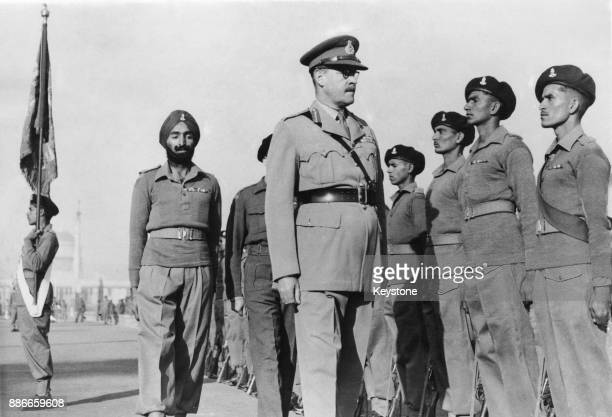 General Sir Francis Robert Roy Bucher inspects a Guard of Honour of the 1st Jats after relinquishing his post as CommanderinChief of the Indian Army...