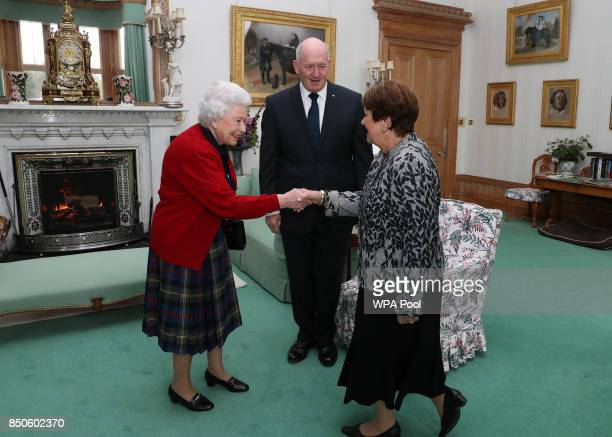 General Sir Peter Cosgrove the GovernorGeneral of Australia with Lady Cosgrove as they meet Queen Elizabeth II during a private audience in the...