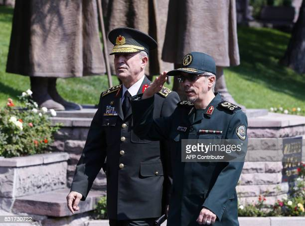 General Staff of the Armed Forces of Iran Mohammad Bagheri salutes the honor guards as he is welcomed by Chief of the General Staff of the Turkish...