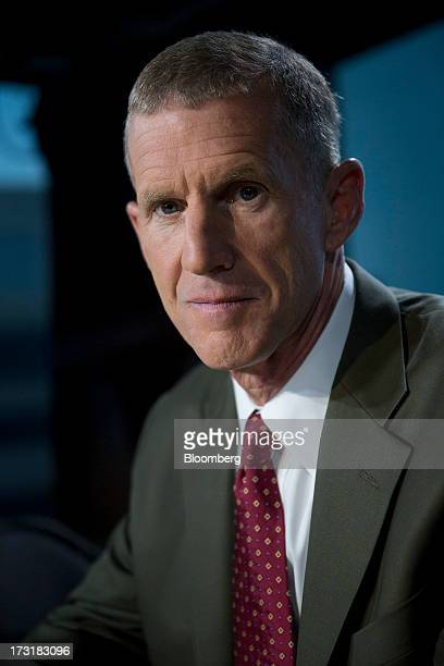 General Stanley McChrystal chairman of Siemens Government Technologies Inc sits for a photograph following a Bloomberg Television interview in...