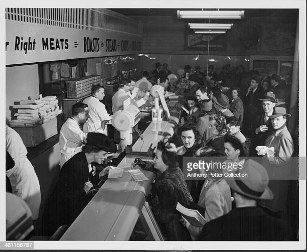 A general store during World War Two Washington reporters gather to preview the rationing system in association with the Office of Price...