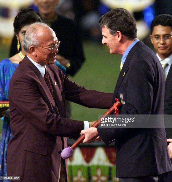General Tan Sri Hashim Mohd Ali Chairman of the Kuala Lumpur Commonwealth Games shakes hands with Councellar Gordon Conquest mayor of Manchester...