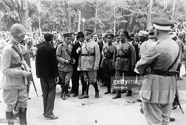 General Tasso Fragoso, president of the provisional junta, is seen above, passing before his troops during a review at the Guanabara Palace, before...