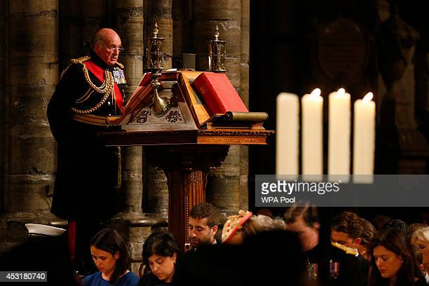 General The Lord Dannatt reads to the congregation during a candlelit vigil and prayer service to commemorate the centenary of the outbreak of the...
