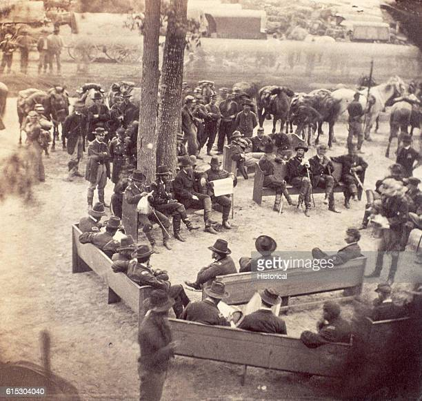 General Ulysses Grant held a council of war outside Massaponax Church Virginia using the church pews as benches Present were Colonel Frederick Dent...