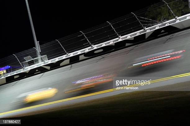 General veiw of cars racing under a sign during the Rolex 24 at Daytona International Speedway on January 29, 2012 in Daytona Beach, Florida.