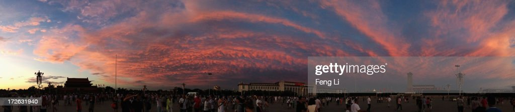 A general veiw of the Tiananmen Square under crimson clouds at sunset after several days of heavy air pollution on July 4, 2013 in Beijing, China.