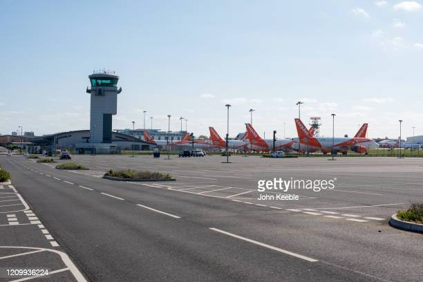 General view across an empty car park of Easyjet passenger planes parked at Southend Airport on April 14, 2020 in London, United Kingdom. EasyJet has...