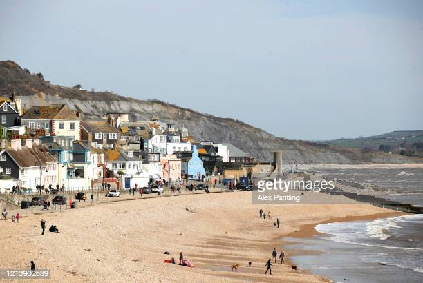 General view across Lyme Regis beach as members of the public go ahead with their daily life on March 21, 2020 in Lyme Regis, West Dorset, England....