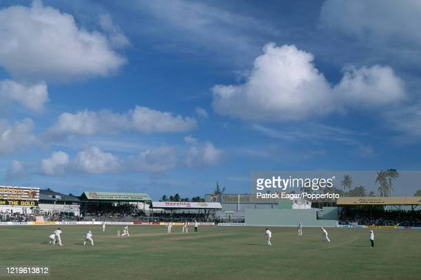 General view across the ground as David Capel of England bowls to Carlisle Best of West Indies during the 4th Test match between West Indies and...