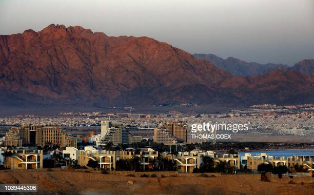 General view ahows the Israeli Red Sea resort city of Eilat and the Jordanian city of Aqaba in the background, on September 24, 2018.