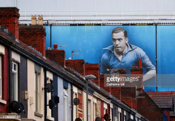 A general view along a residential street showing a mural of Dixie Dean on the outside of the stadium ahead of the Premier League match between...