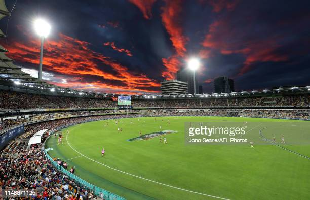 General view and sunset during the round seven AFL match between the Brisbane Lions and the Sydney Swans at The Gabba on May 04, 2019 in Brisbane,...