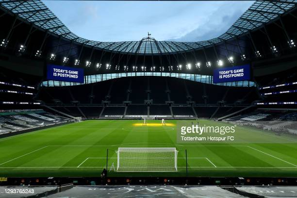 General view as a board inside the stadium displays 'Today's Game is Postponed' for the Premier League match between Tottenham Hotspur and Fulham at...