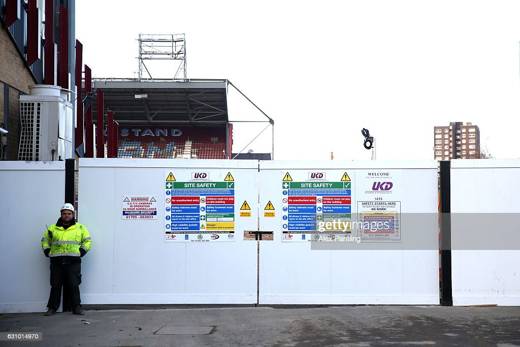 A general view as a builder stands outside the stadium during the demolition of West Ham's Boleyn Ground on January 5, 2017 in London, England. Local businesses are suffering as the former West Ham United ground is being demolished to make way for more than 800 homes.