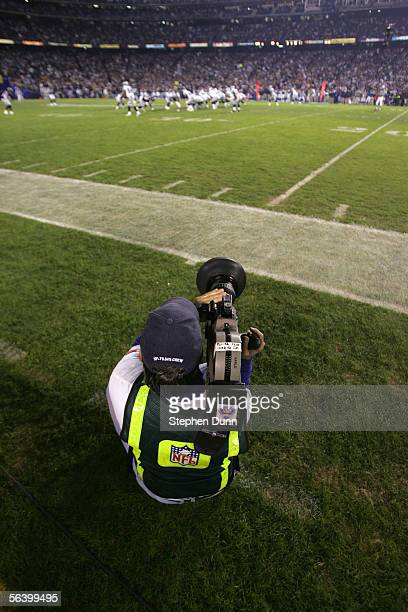 A general view as a camera man for NFL Films kneels on the sidelines to shoot the action taken during the game between the San Diego Chargers and the...