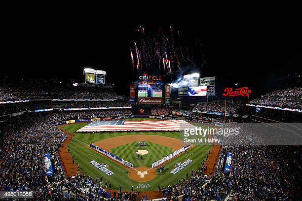 General view as a giant American Flag is displayed on the field prior to Game Three of the 2015 World Series at Citi Field between the New York Mets...