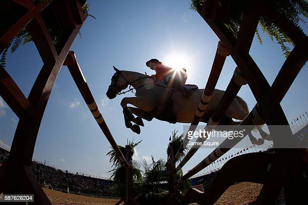 General view as a horse and rider jump during the eventing team jumping final and individual qualifier on Day 4 of the Rio 2016 Olympic Games at the...