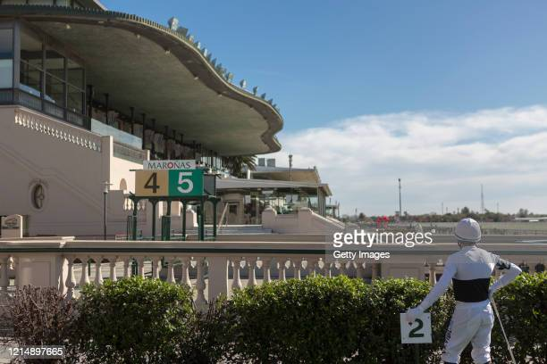 General view as a jockey waits for the race keeping the social distance during competition day as Uruguay slowly returns to normal due to coronavirus...