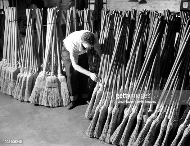 General view as a man bundles brooms at the Lighthouse Institute for the Blind on October 16, 1948 in Brooklyn, New York.