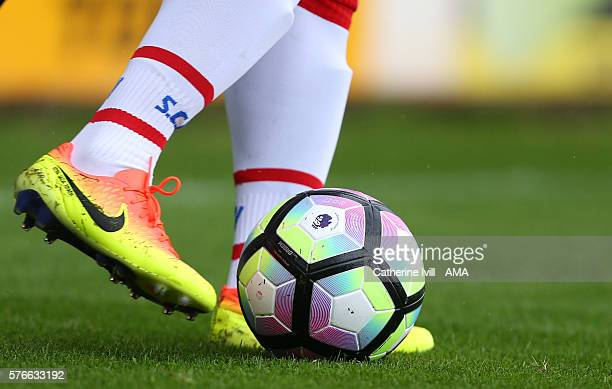 General view as a player wearing Nike boots kicks the Nike Ordem 4 match ball for the Premier League during the PreSeason Friendly match between...