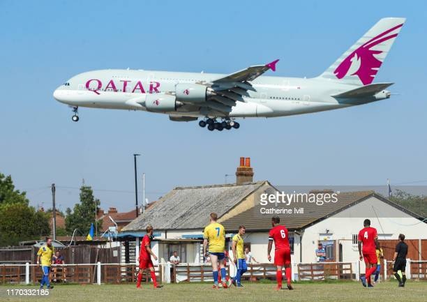 General view as a Qatar Airways aeroplane comes in to land at Heathrow Airport during the Cherry Red Records Combined Counties Football League...