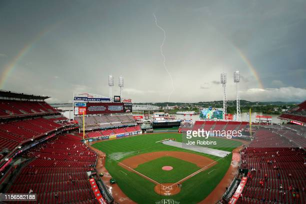 General view as a rainbow forms and lightning strikes above the ball park during a rain delay in the game between the Houston Astros and Cincinnati...