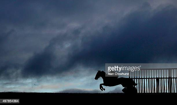 A general view as a runner clears a flight of hurdles on the back straight at Wincanton racecourse on November 19 2015 in Wincanton England
