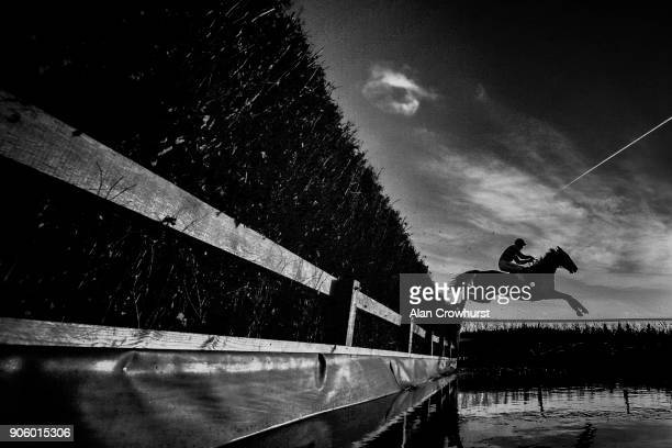 A general view as a runner clears the water jump at Newbury racecourse on January 17 2018 in Newbury England