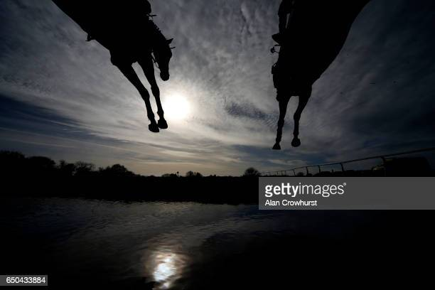 A general view as a runner clears the water jump at Wincanton Racecourse on March 9 2017 in Wincanton England