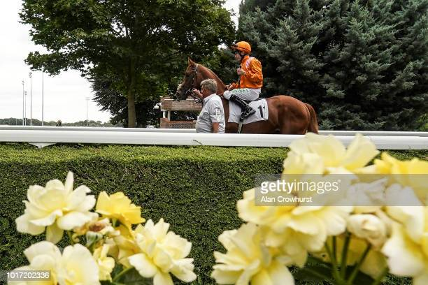 Andre Atzeni riding Angels Glory win The Breeders Backing Racing EBF Fillies' Novice Stakes at Kempton Park on August 15 2018 in Sunbury England