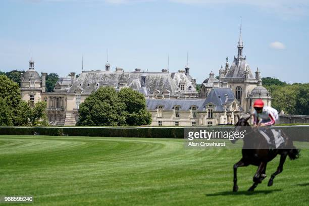 A general view as a runner pass The Chateau de Chantilly during the Prix du Jockey Club meeting at Hippodrome de Chantilly on June 3 2018 in...