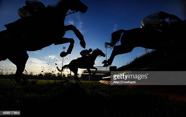 A general view as a runners clear a fence at Kempton Park racecourse on November 24 2014 in Sunbury England