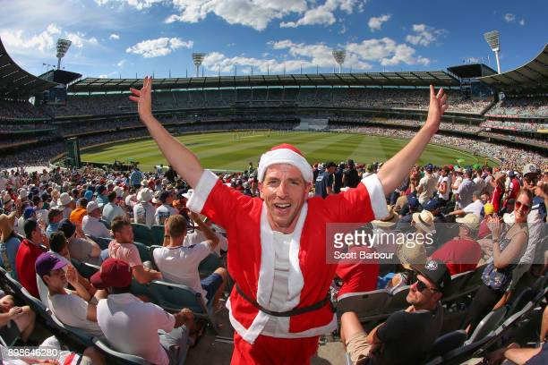 A general view as a spectator dressed as Santa Claus enjoys the atmosphere in the crowd of 88172 on Boxing Day during day one of the Fourth Test...