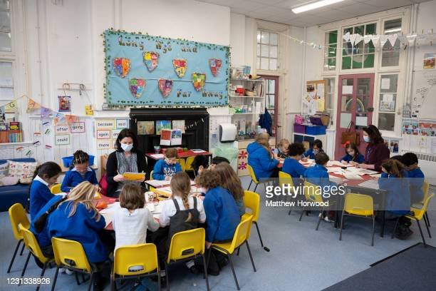 General view as a teacher holds a creative writing class at Roath Park Primary School on February 23, 2021 in Cardiff, Wales. Children aged three to...