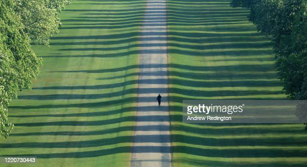 General view as a woman exercises on The Long Walk on April 24, 2020 in Windsor, England. The British government has extended the lockdown...