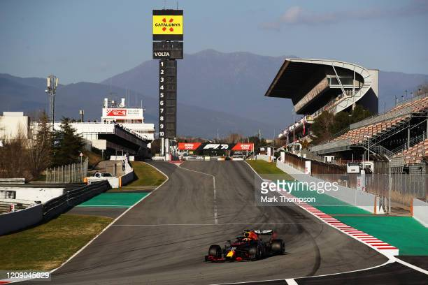 General view as Alexander Albon of Thailand driving the Aston Martin Red Bull Racing RB16 approaches turn one during Day Two of F1 Winter Testing at...