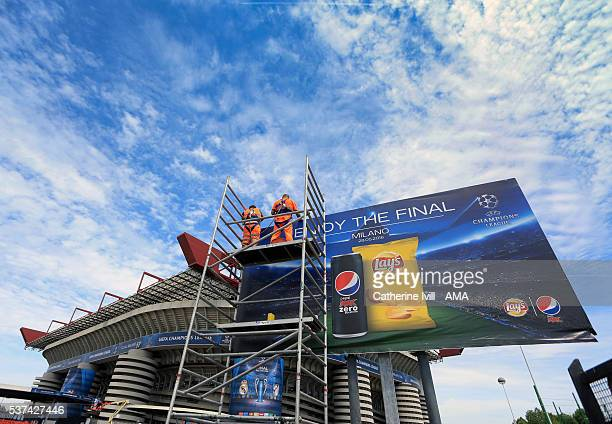 General view as an advert for sponsors Pepsi Max and Lays are put up outside the San Siro stadium ahead of the final at Stadio Giuseppe Meazza on May...
