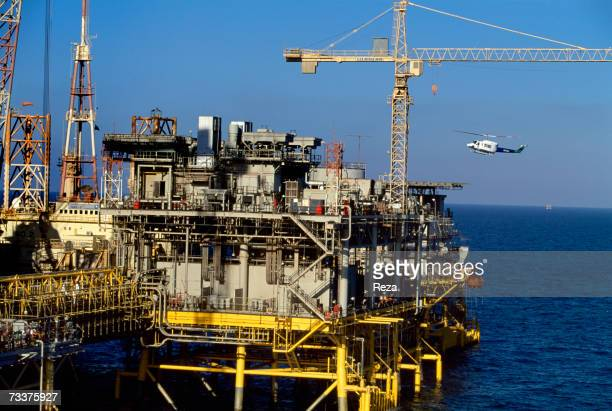 General View as an Aramco helicopter lands on a helipad on the offshore oil rig Marjan 2 in the Persian Gulf on March 2003 in Persian Gulf Saudi...