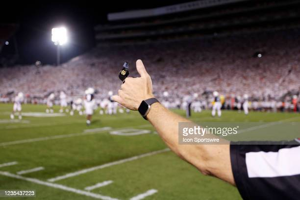 General view as an official holds up his hand and SEC logo whistle during a college football game between the Auburn Tigers and Penn State Nittany...