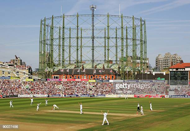 A general view as Andrew Flintoff of England celebrates the run out of Ricky Ponting of Australia with team mates during day four of the npower 5th...