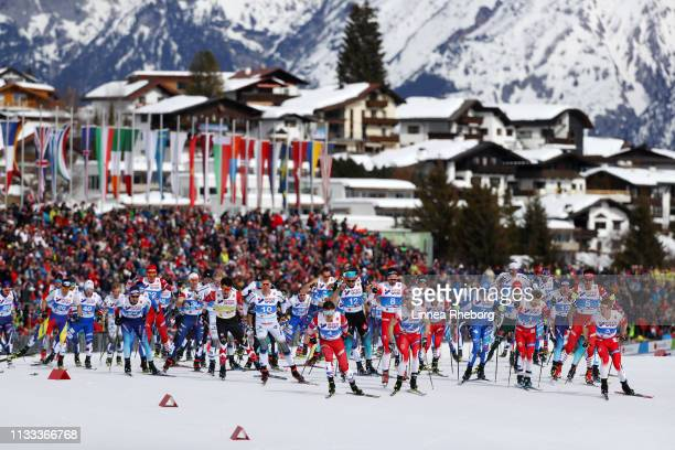 A general view as Andrey Melnichenko of Russia leads the field in the mass start of the Men's Cross Country 50k race during the FIS Nordic World Ski...